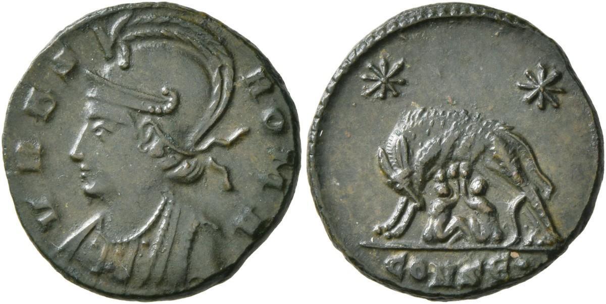 Descrição para deficientes visuais: Moeda retratada com seu anverso a efigie de Constantino I e no seu reverso a deusa Lupa amamentando os gêmeos Rômulo e Rêmulo.